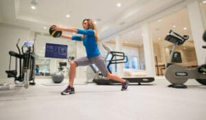 woman working out on home gym flooring